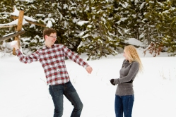 Fun snow engagement photos Snowy Swan Mountain Colorado engagement photo session