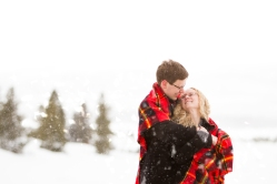 How to take photos in the snow for a Snowy Swan Mountain Colorado engagement photo session