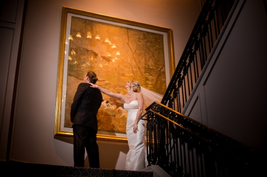 First look on stairs Crazy Fun New Orleans Wedding at Il Mercato