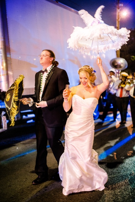Awesome Second Line Umbrellas and band Crazy Fun New Orleans Wedding at Il Mercato